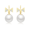 Golden bowtie pearl earings COCOMISS